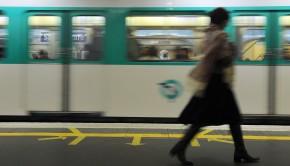 A woman walks on a plateform of Parisian
