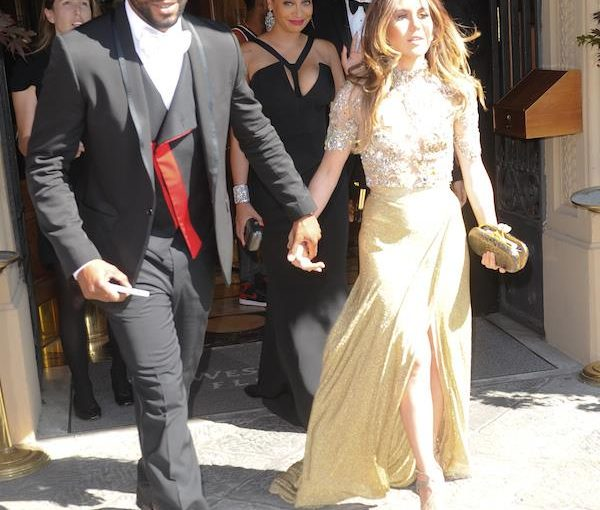 Amber Ridinger in Gold Gown at Kim & Kanye's Wedding