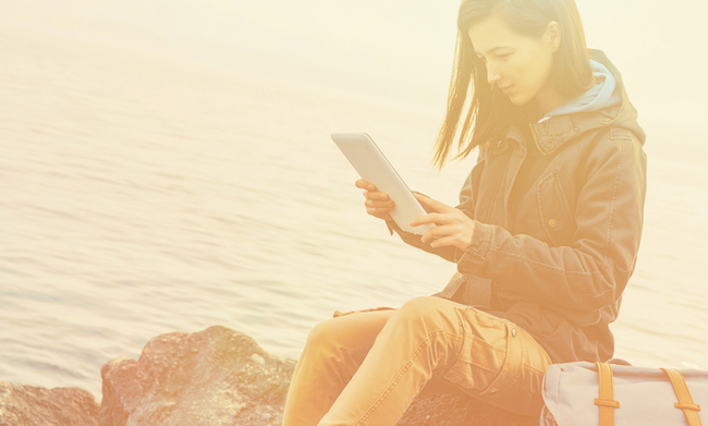 best books to read while traveling, woman, reading, tablet, kindle