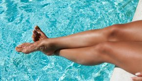 glowing summer skin tanned legs poolside