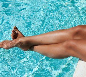 glowing summer skin tanned legs poolside